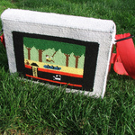 Needlepoint Laptop Case Depicting Pitfall