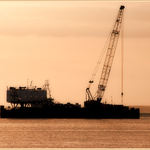 A Ship Dredging The Waterways