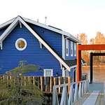 Blue Floating Home at Sundown