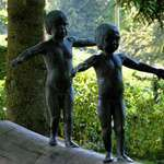 """""""Continuity"""" - bronze statues of boy & girl"""